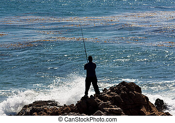 Man Fishes Against the Crashing Ocean Waves at Leo Carillo ...