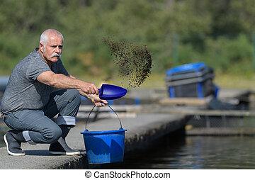 man fishing feed