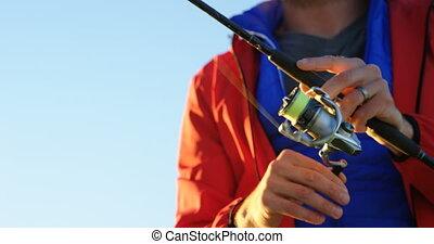 Man fishing in river 4k - Close-up of man fishing in river...