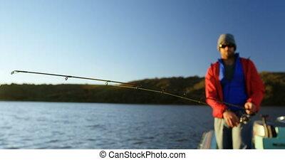 Man fishing in river 4k - Man fishing in river on a sunny...