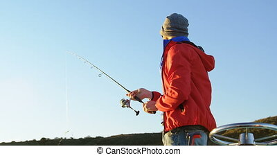 Man fishing in river 4k - Side view of man fishing in river...