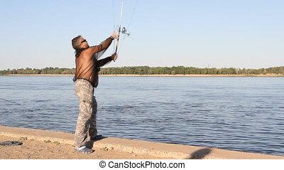 man fishing on a river - man fishing on a river at sunny day...