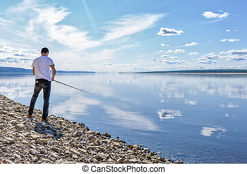 Man fishing on the river