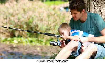 Man fishing with his little boy