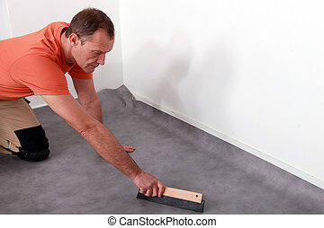 Man fitting a lino floor