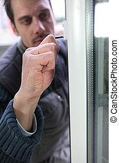 Man fitting a new window