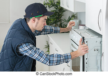Man fitting new oven