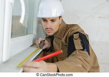 man fitting window