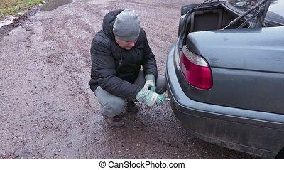 Man fix car tow bar in car