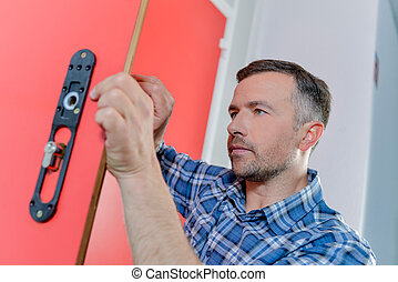 Man fixing a door