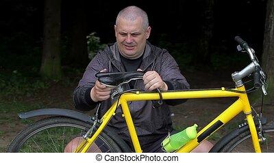 Man fixing bicycle seat