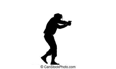 Man flee holding a gun in hand. Silhouette - Man flee...