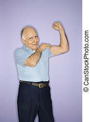 Man flexing muscles. - Caucasian mature adult male flexing ...