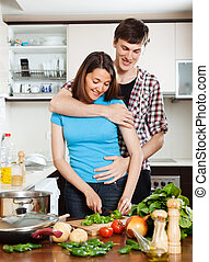man flirting with  pretty girl in  kitchen