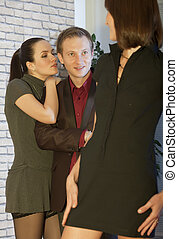 man flirting with two women