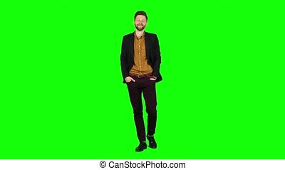 Man flirts, he smiles and builds his eyes. Green screen -...