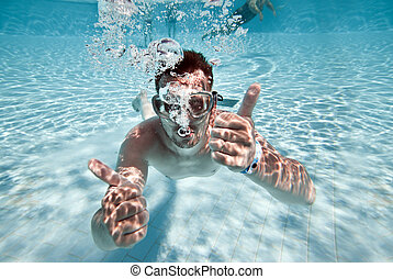 man floats in pool - man floats underwater in pool