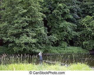 man fly fishing in river ourthe near la roche en ardennes in...