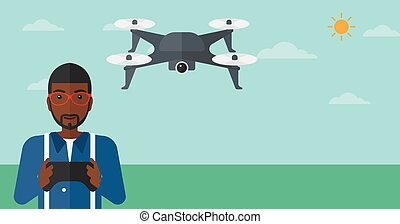 An African American Man Flying Drone