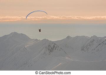 Man flying on the parachute in Gudauri, Georgia - Man flying...