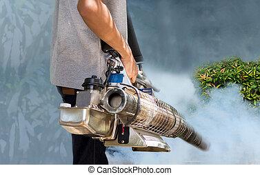 Man fogging mosquito to prevent of dengue fever