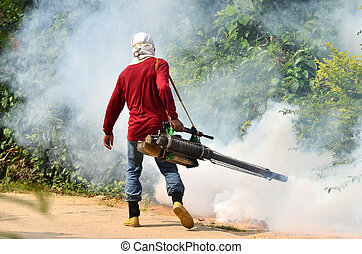 Fogging to prevent spread of dengue fever - man Fogging to...