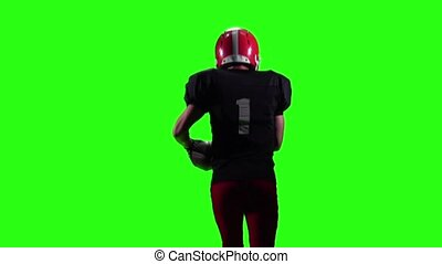 Man football player running with the ball. Slow motion, green screen
