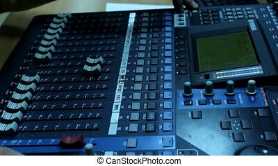 television audio mixer - man for the television audio mixer...