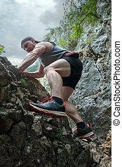 Man free climbing on mountain