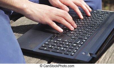 Man freelancer typing something on laptop