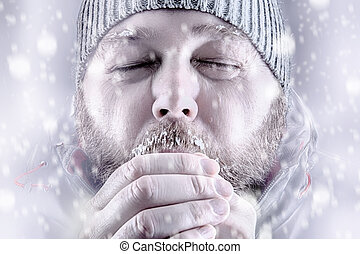 Man freezing in snow storm white out close up