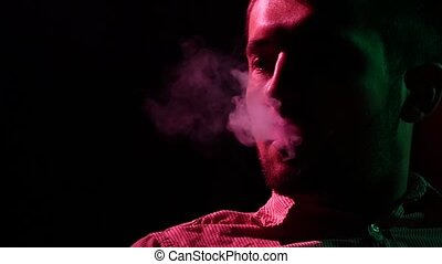 Man from a Hookah, Slow motion. silhouette - Man Inhaling...