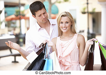 Man Frustrated With Woman On Shopping Trip Together