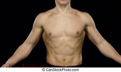 Man fulfills a sports training program. Black. Close up