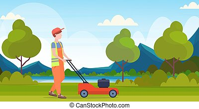 man gardener in uniform cutting grass with lawn mower gardening concept beautiful river mountains landscape background flat full length horizontal