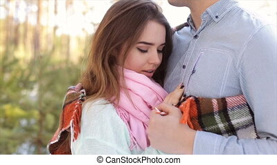 Man gently hug the girl's shoulders in the open air in the...