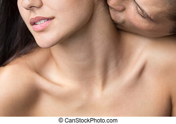 Man gently kissing naked beautiful woman on neck, closeup view