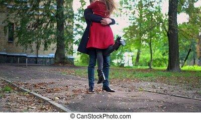 Man gently lifts pretty woman in slow motion