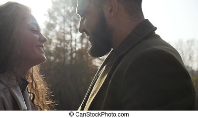 Man gently touching face of woman - Bearded man gently...