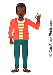 Man gesturing OK sign. - An african-american man gesturing...