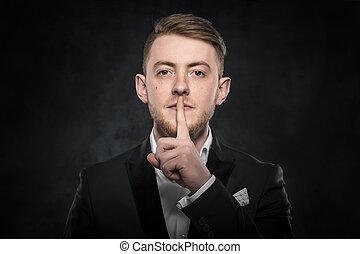 Man gesturing silent. - Man gesturing silent on a dark...