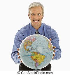 Man gesturing with globe.