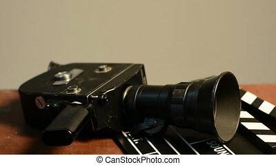 Man gets a spring mechanism on a retro movie camera.