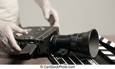 Man gets a spring mechanism on a retro movie camera....