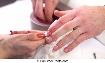 Man gets nails manicure at beauty salon - Man gets manicure...