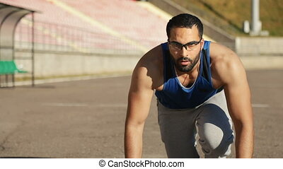 Man Gets Ready to Start Jogging