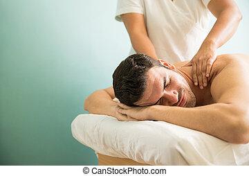 Man getting a deep tissue massage