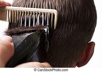 man getting a haircut by a hairdresser.