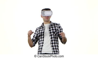 Man getting experience in using VR-headset. White background...