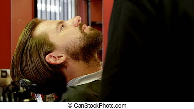Man getting his beard trimmed with trimmer 4k